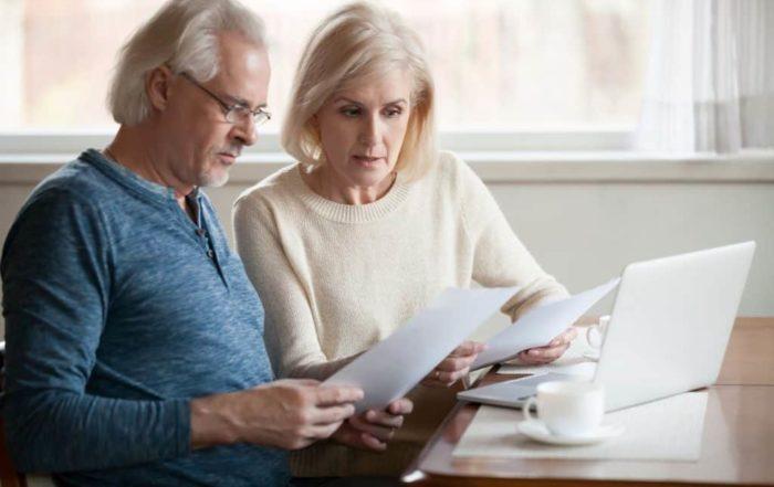 Senior Couple reviewing DIY estate planning